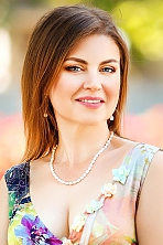 Ukrainian girl Lilia,44 years old with grey eyes and light brown hair.