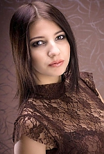 Ukrainian girl Daria,21 years old with hazel eyes and dark brown hair.