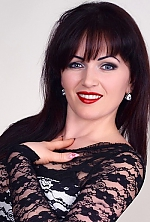 Ukrainian girl Tatiana,32 years old with blue eyes and dark brown hair.