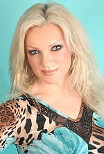 Ukrainian girl Elena,51 years old with green eyes and blonde hair.