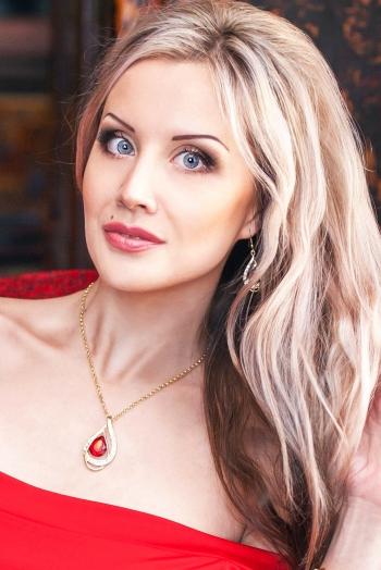 Ukrainian girl Ekaterina,29 years old with black eyes and blonde hair.