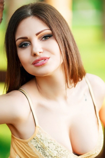 Ukrainian girl Karina,26 years old with green eyes and black hair.