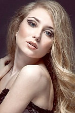 Ukrainian girl Alina,24 years old with blue eyes and blonde hair.