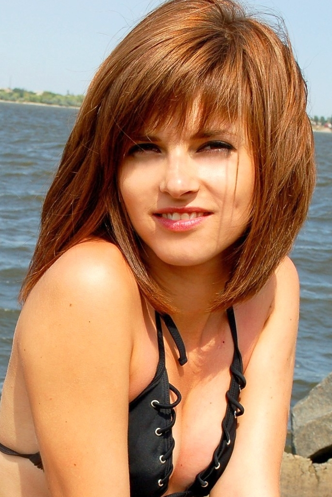 Ukrainian girl Yana,25 years old with brown eyes and dark brown hair.