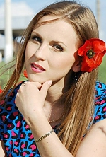 Ukrainian girl Anna,29 years old with green eyes and light brown hair.