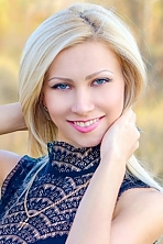 Ukrainian girl Anna,29 years old with blue eyes and blonde hair.