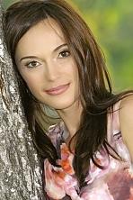 Ukrainian girl Oksana,36 years old with brown eyes and dark brown hair.
