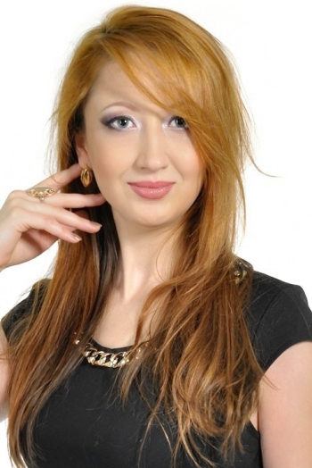 Ukrainian girl Svetlana,27 years old with green eyes and auburn hair.