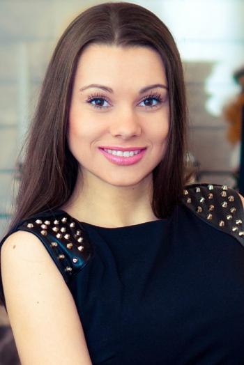 Ukrainian girl Maria,27 years old with brown eyes and dark brown hair.