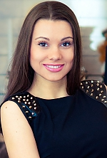 Ukrainian girl Maria,26 years old with brown eyes and dark brown hair.