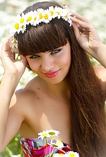 Ukrainian girl Alena,31 years old with green eyes and dark brown hair.