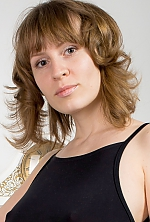 Ukrainian girl Ksenia,33 years old with brown eyes and light brown hair.