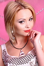 Ukrainian girl Natalia,30 years old with brown eyes and blonde hair.