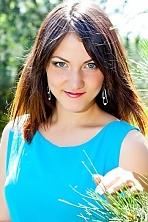 Ukrainian girl Juliya,20 years old with grey eyes and dark brown hair.