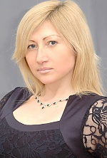 Ukrainian girl Ana,34 years old with blue eyes and blonde hair.