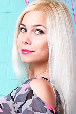 Ukrainian girl Julia,27 years old with grey eyes and blonde hair.