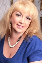 Ukrainian girl Svetlana,54 years old with green eyes and blonde hair.