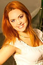 Ukrainian girl Natalia ,42 years old with green eyes and auburn hair.