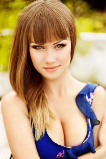 Ukrainian girl Svetlana,26 years old with green eyes and light brown hair.