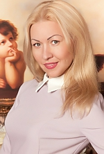 Ukrainian girl Irina,42 years old with grey eyes and blonde hair.