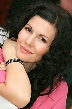 Ukrainian girl Oksana,36 years old with brown eyes and black hair.