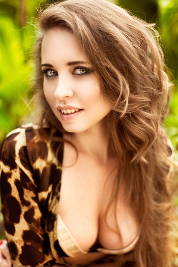 Ukrainian girl Anastasia,28 years old with blue eyes and light brown hair.