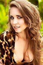 Ukrainian girl Anastasia,27 years old with blue eyes and light brown hair.