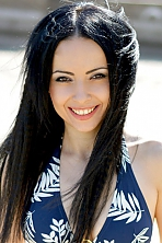 Ukrainian girl Elena,30 years old with brown eyes and black hair.