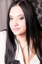 Ukrainian girl Lili,25 years old with brown eyes and black hair.