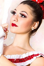 Ukrainian girl Kate,22 years old with black eyes and dark brown hair.