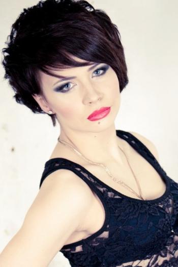 Ukrainian girl Inessa,24 years old with grey eyes and dark brown hair.