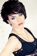 Ukrainian girl Inessa,24 years old with grey eyes and dark brown hair.