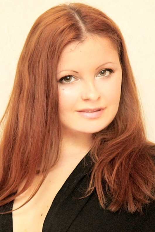 Ukrainian girl Natalia,34 years old with green eyes and red hair.