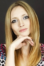 Ukrainian girl Anastasia,25 years old with green eyes and light brown hair.