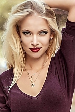 Ukrainian girl Elizaveta,25 years old with grey eyes and blonde hair.