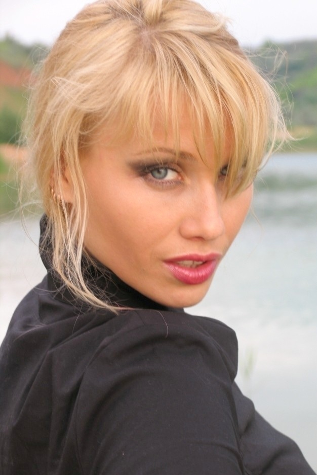 Ukrainian girl Ekaterina,37 years old with green eyes and blonde hair.