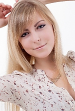 Ukrainian girl Olga,22 years old with blue eyes and blonde hair.