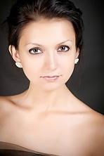 Ukrainian girl Lidia,25 years old with brown eyes and dark brown hair.