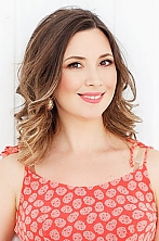 Ukrainian girl Ludmila,43 years old with brown eyes and light brown hair.