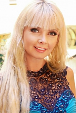 Ukrainian girl Viktoriya,43 years old with blue eyes and blonde hair.