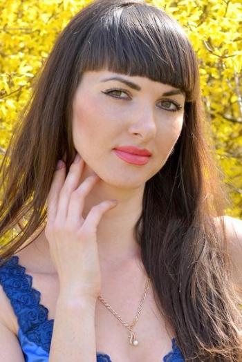 Ukrainian girl Elena,29 years old with hazel eyes and dark brown hair.