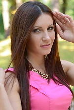 Ukrainian girl Juliya,30 years old with green eyes and dark brown hair.