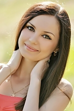 Ukrainian girl Oksana,24 years old with brown eyes and dark brown hair.