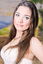 Ukrainian girl Alina,23 years old with grey eyes and light brown hair.