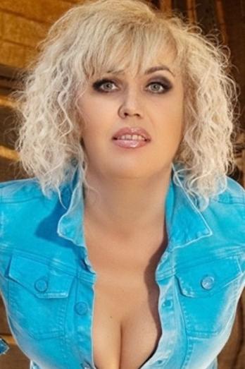 Ukrainian girl Oksana,46 years old with green eyes and blonde hair.