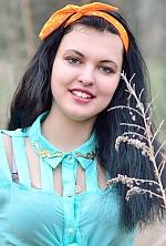 Ukrainian girl Olya,21 years old with green eyes and black hair.
