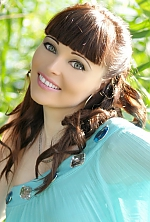Ukrainian girl Olga,32 years old with brown eyes and dark brown hair.