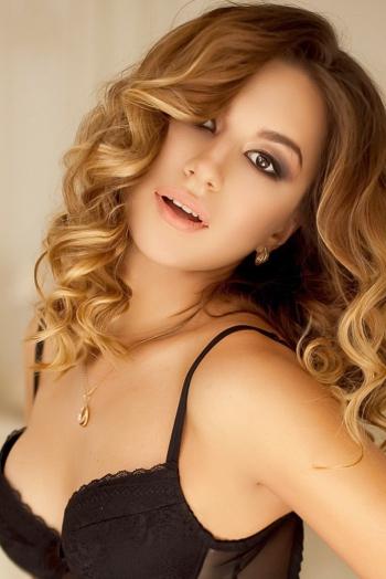 Ukrainian girl Olga,25 years old with brown eyes and dark brown hair.