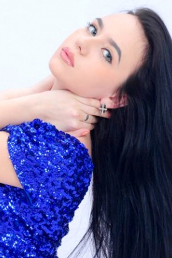Ukrainian girl Julia,22 years old with grey eyes and black hair.