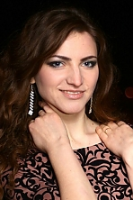 Ukrainian girl Anna,24 years old with blue eyes and light brown hair.